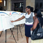 consultant talks with public meeting attendee at Union Station