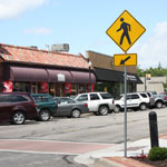 parked cars and crosswalk sign in downtown Overland Park