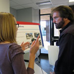 MARC staff member talks with open house attendee